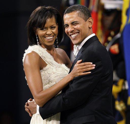 <center><b>Барак Обама ценит формы своей жены</center></b>